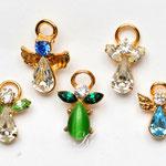 Лот №НГ83.Маленькие брошечки-ангелы с разнообразными кристаллами.Хорошая сохранность,размеры от 2 до 1.5 см.Цена одного-150 грн.