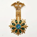 Лот №П606.Винтажная брошь в геральдическом стиле от Florenza(подробнее о дизайнере в разделе *Известные марки*).Прекрасное состояние,маркирована,размер-8.5х4.5 см. ПРОДАНА