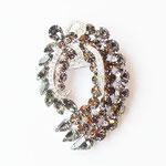 Лот №П384.Необыкновенной красоты брошь 50-х годов от WEISS (см.*Известные винтажные марки*),в идеально новом состоянии,маркирована.Ювелирный сплав под серебро,австрийские кристаллы наивысшего качества,необыкновенный дизайн.Размер-7х5 см.ПРОДАНА