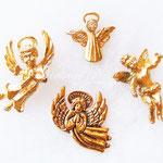 Лот №106.Небольшие брошечки-ангелы.Все в хорошем состоянии.Размер-около 2 см.Цена одного-100 грн.