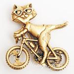 Лот №П475.Котик на велосипеде от компании A.J.C, маркирован,состояние-новое.Размер-4.3 см.ПРОДАН