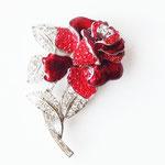 Лот №П377.Роза Nolan Miller из коллекции Glamour (см.*Известные винтажные марки*).Брошь новая,маркирована,в фирменной упаковке. Эффект цветка в 3D, комбинация эмали к кристаллов Сваровски. Размер-7х5 см,достаточно массивная и увесистая.ПРОДАНА