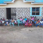 The children in front of their home...