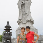 Mery with mom infront of the Kuan Yin statue