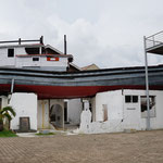 Banda Acehy ship that was stranded on the roof of a house after the tsunami in 2004