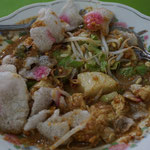 Lontong kacang, rice paste with vegetables in peanut sauce