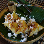 Lupis, sticky rice with coconut and red sugar