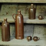 Schlanke Flaschen und Schnapsstamper