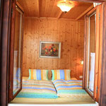 Schlafzimmer Apartment Gosaukamm © Christine Bleisch