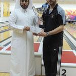 Fahad Al-Emadi received his cash prize awarded by Mr. Bandar Al Shafi - Secretary General of the Qatar Bowling Federation.