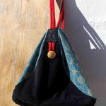 Hier hängt der All-In-One-Taschen-Rucksack als Tasche