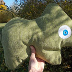 grünes Tierchen-Polster im grünen