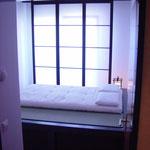 Bett und Raumteiler