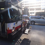 Bike rake in front of a bus - got to love it