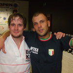 Irish Open Champions Richie Wooton poses with an Italian competitor