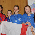 Nicola Gemmill on the podium with the Girl's Semi Contact Team