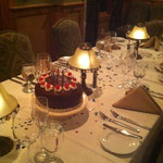 A birthday celebration for a guest in the restaurant - Chef's homemade black forest cake