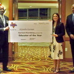 James Harrison presenting 2012 Educator of the Year Award to Alejandra Guzman.