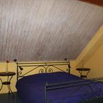 eines der oberen Schlafzimmer