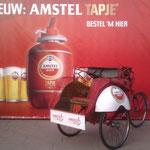 Promotie Amstel Tapje, reclamebord en wielkastbestickering voor VIP-vervoer in stijl