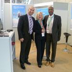 Die DCK med GmbH freut sich auf eine erfolgreiche FIBO 2013 - von links nach rechts - Erkan Kilic, Carmen von Cube und Edwin D. Dangerfield