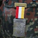 Medaille als Belohnung für 4x15 Kilometer