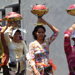 Local women carrying offerings to the temples