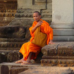 A monk in the evening sun at the Angkor Wat ruins
