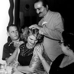 Meher Baba  with Virginia & Harold Rudd in Longchamps Restaurant, Manhattan House, New York - 22 July 1956