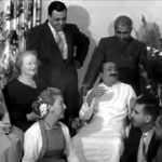 Marion is seated on Baba's left