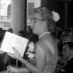 Marion making announcements at Longchamps Restaurant, New York.