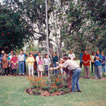 Meheru Irani hoisting Baba's Flag during an anniversary, assisted by Roy Hayes