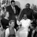Don is seated on Baba's right