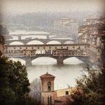 Ponte Vecchio, an arch bridge over the Arno River