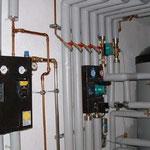 Heizungsverteilung Fußboden-und Heizkörperkreis mit OPTIMA 1000Frischwasserspeicher und 3 CDC21 Röhrenkollektoren