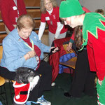 Joanne MacGregor with Winston visiting with one of Santa's elves.