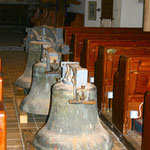 Three bells stored in the main aisle