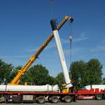 Umzug der beiden Kamine (12 Meter hoch) für die Ölbrenner zur neuen Heizzentrale
