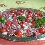Parmaschinken mit Parmesanraspel
