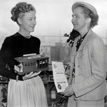 """receiving a certificate from Mrs. Hans Klussmann in recognition of her contribution to the """"Save the Cable Cars"""" campaign"""