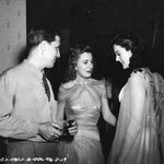 on the set of 'Penny Serenade' with director George Stevens and guest Rosalind Russell