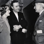 on the set of 'When Tomorrow Comes' with Charles Boyer and director John M. Stahl