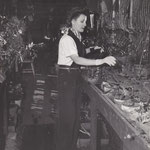 at home in her greenhouse