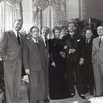 on the set of Life With Father with Michael Curtiz (left), Jack Warner (third from left) and other unknown visitors