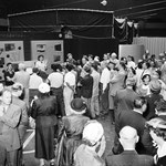 "1952 with Frank at the ""Alert America"" civil defense exhibit (standing at the right side, Irene wearing glasses)"