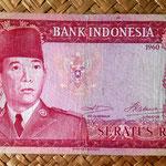 Indonesia 100 rupias 1960 (156x78mm) pk. 86a anverso