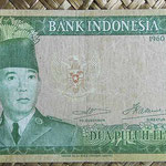 Indonesia 25 rupias 1960 (144x72mm) pk.84a anverso