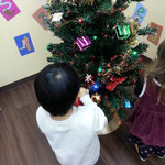 Helping with the Christmas tree