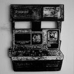 """Polaroid"" Troquelado en trupan esmalte plateado y tinta oleográfica 38cm X 27cm"