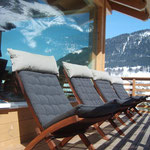 Balcony with deck chairs